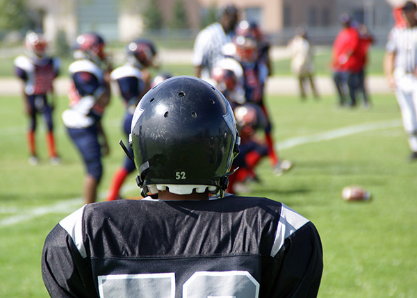 Common Spinal Injuries While Playing Football and How to Avoid Them